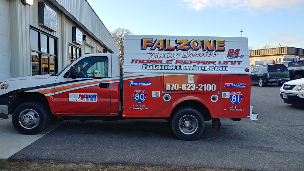 side view of large truck wrap design